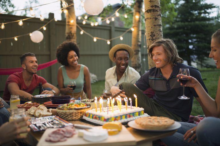friends enjoying backyard birthday party 57f51a0f3df78c690fcf15c5