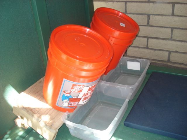 Build your own 5 gallon dog auto feeder It does work Simple 5 gallon bucket with lid plastic tray on a slanted wood base