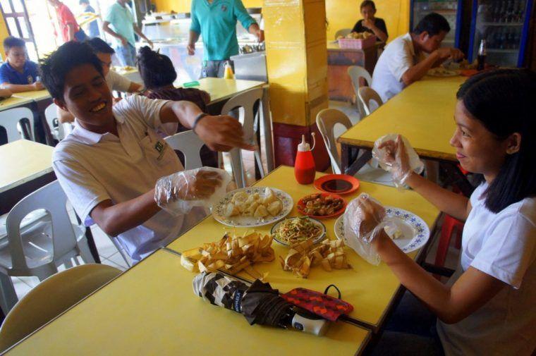 Locals enjoying their lunch in Manila