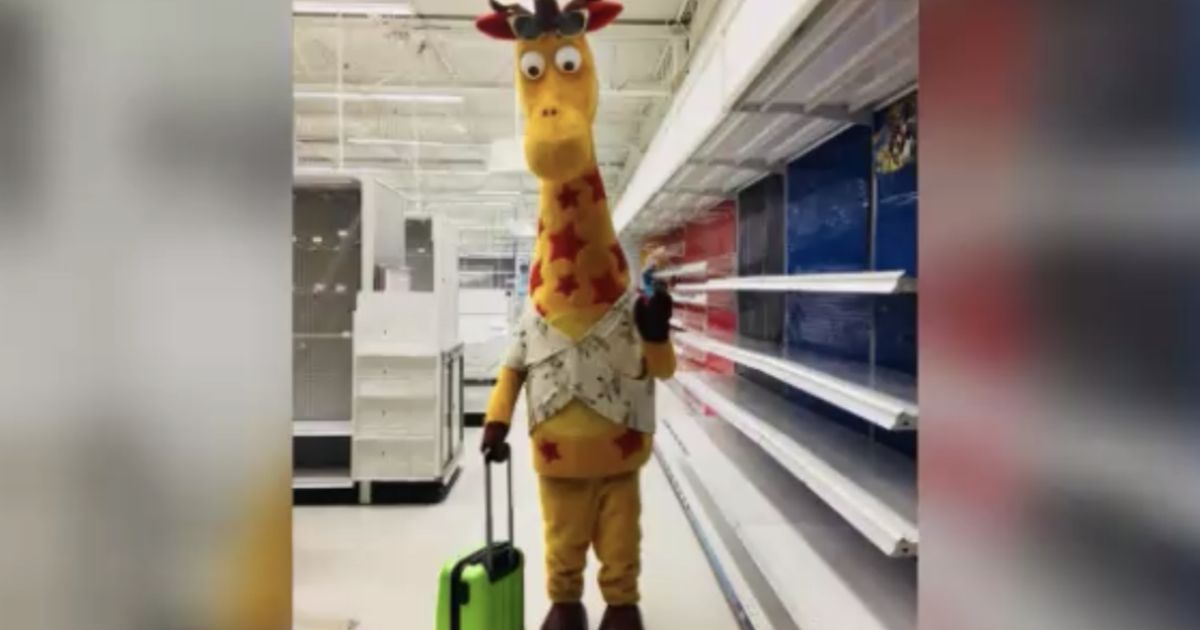 """of Geoffrey the Giraffe leaving an empty Toys """"R"""" Us store goes viral CBS News"""