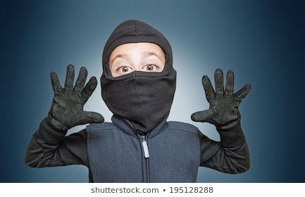 Surprised ic burglar stopped and take his hands up