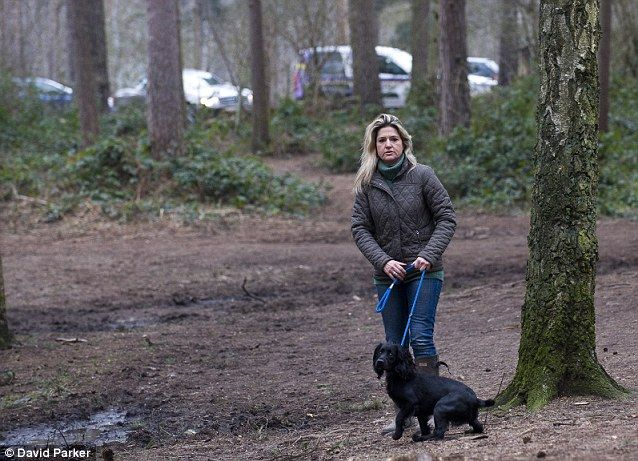 Melissa Kite with her dog Cydney at the woods where she walks everyday and regularly