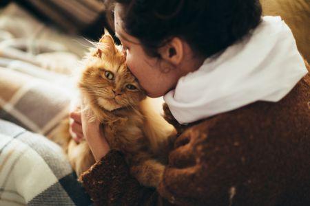 woman kissing cat 5908c1455f9b f9d4